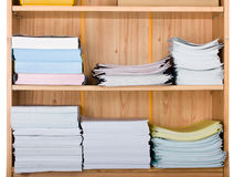 Shelf with paper. Wooden shelf with brochures and piles of paper Royalty Free Stock Photos