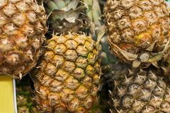 Shelf with pineapples in store Stock Photo