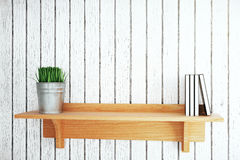 Shelf with plant and books. Wooden shelf with plant and books on grey plank background. Mock up, 3D Rendering Royalty Free Stock Image