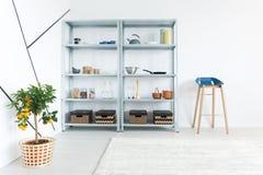 Shelf in room. Metal simple shelf in white minimalist room Royalty Free Stock Image