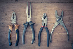 Shelf with a set of old pliers Stock Images
