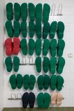 A shelf with several surgical shoes stock photos