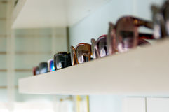 Shelf of sunglasses Royalty Free Stock Photography