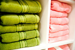 Shelf with a towels. Big shelf with a colorful towels Royalty Free Stock Photos