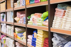 Shelf with towels in a supermarket Stock Images