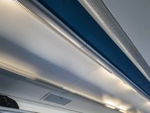 A shelf under the ceiling of the train for hand luggage royalty free stock photo