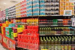 Shelf with various brands of soda in cans. SINGAPORE- NOV 11, 2017: Grocery store shelf with various brands of soda in cans Stock Image