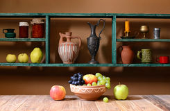 Shelf with various things and fruits Royalty Free Stock Photo