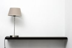 Shelf on the wall with lamp Royalty Free Stock Image
