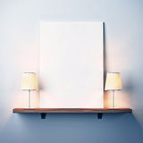 Shelf with white poster and two lamps. Shelf on a wall with white poster and lamps royalty free stock photo
