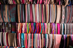 Shelf with a wide selection of colorful fabrics. Stock Images