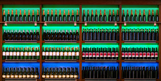 Shelf with wine bottles Royalty Free Stock Images