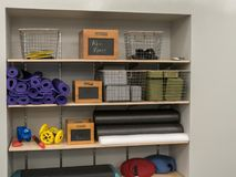 Shelf of work out equipment in modern gym. Yoga, classes, stretching Stock Photos