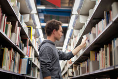 Shelfs in the library. Student in book shop or lbrary Stock Image