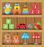 Shelfs med leksaker Arkivbild