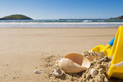 Shell, bucket and spade. Stock Images