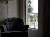 Shell Chair. Scenic view of chair and window Royalty Free Stock Photos