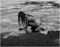 Shell Collecting. A pic of a little girl looking for shells at Punalu'u Beach. More of a candid, I guess Royalty Free Stock Photos