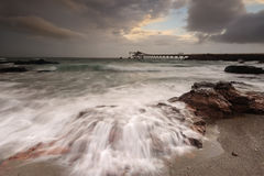 Shell Cove flows on a stormy day Stock Photo