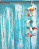 Shell decoration hanging on wood wall background. Royalty Free Stock Photography
