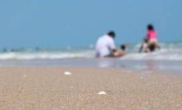 Shell do mar com fundo de família borrado Imagem de Stock Royalty Free