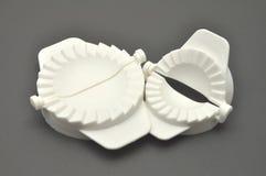 Shell dumpling maker Stock Image