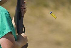 Shell eject. Shot gun shell being ejected from the chamber Royalty Free Stock Images