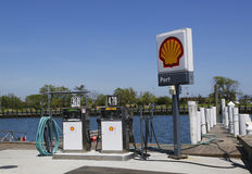 Shell fuel station for boats on the dock in Freeport, Long Island. FREEPORT, NEW YORK - MAY 29: Shell fuel station for boats on the dock in Freeport, Long Island Stock Photos