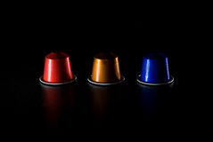 Shell game cups. Three inverted plastic cups used in the shell game, isolated on black background stock photography