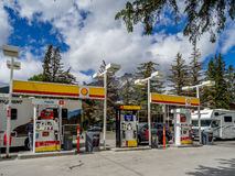 Shell gas station, Banff. BANFF, ALBERTA - JUNE 19: Tourists filling up at a Shell gas station on June 19, 2015 in Banff, Alberta Canada. Banff National Park is royalty free stock photography