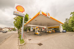 Shell gas station. Shell fuel station with some dark clouds royalty free stock photo