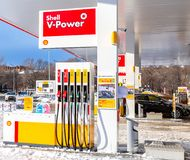Shell gas station with fueling cars. Samara, Russia - January 8, 2018: Shell gas station with fueling cars in wintertime royalty free stock photos