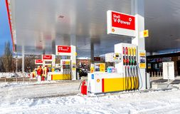 Shell gas station with fueling cars. Samara, Russia - January 8, 2018: Shell gas station with fueling cars in wintertime stock photos