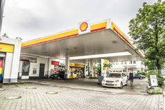 Shell gas station. Shell petrol station with customers and copy space royalty free stock photos