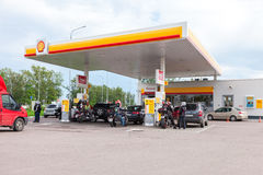 Shell gas station in summer day. Royal Dutch Shell oil company i Royalty Free Stock Images