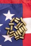 Shell gastos na bandeira dos Estados Unidos Fotografia de Stock