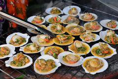 Shell Grill. Shell with fresh butter on the hot pot grill, Thai sea food Royalty Free Stock Photo