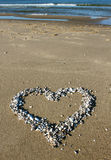 A Shell heart on the beach Royalty Free Stock Photo