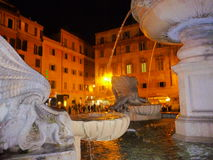 Shell like fountain in white marble Rome Italy. Shell like fountain in white marble ( sculptor artist Bramante) at Trastevere the iconic quarter of the Rome Stock Photography