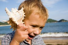 Shell & little boy Stock Photos