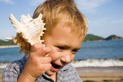 Shell & little boy Stock Photos