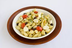 Shell Macaroni and chesse with tomato. Macarnoni Shells with Mozzarella cheese, tomato, black olives, in light olive oil.  A Healthy Pasta salad Royalty Free Stock Photo