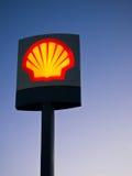 Shell Oil Company Logo Illuminated. Illuminated sign for the global Shell Oil Company. Evening light, Costa del Sol, Spain royalty free stock image