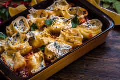 Shell pasta stuffed with spinach, cream cheese, Parmesan in tomato sauce Stock Photography