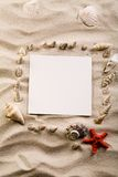 Shell, sand & sheet of paper Stock Photography