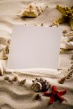 Shell, sand & sheet of paper Royalty Free Stock Photos