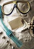 Shell, Sand u. Blatt Papier Lizenzfreie Stockbilder