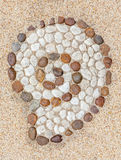 Shell shape stone decorated on gravel floor texture. Stock Photography