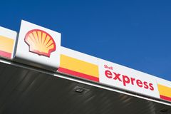 Shell sign against blue sky. Shell is an Anglo-Dutch multinational oil and gas company headquartered in the Netherlands and incorporated in the UK Stock Photo