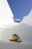 Shell on the steps. A closeup of a seashell on a flight of white steps in typical Greeck architecture Stock Image